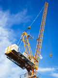 Crane work in construction site with blue sky background Royalty Free Stock Images