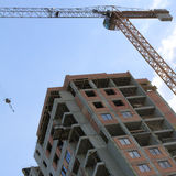 Crane work helps the growth of the construction Stock Photography