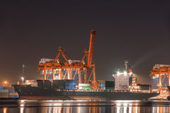 Crane work in night port Stock Photography