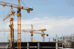 Crane. And worker at construction site Royalty Free Stock Photo