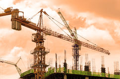 Crane and workers at construction site Royalty Free Stock Photo