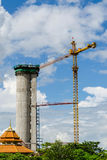 Crane and workers at construction site. Royalty Free Stock Images