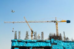 Crane working in construction site Royalty Free Stock Image