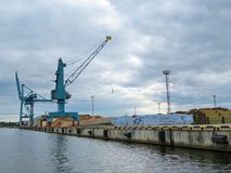 Crane working with cargo in Baltic sea, Latvia Stock Photography