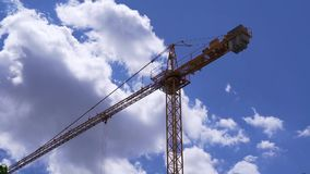 The crane is working on the clockwork.  stock footage