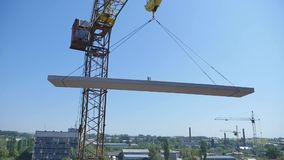 Crane working in construction on blue sky.  stock footage