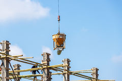 Crane working in construction on blue sky Royalty Free Stock Images