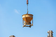Crane working in construction on blue sky Stock Photos