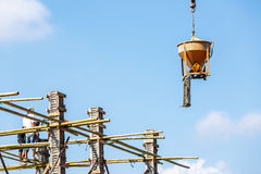 Crane working in construction on blue sky Royalty Free Stock Photos