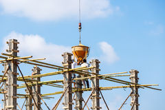 Crane working in construction on blue sky Royalty Free Stock Image