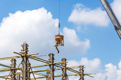 Crane working in construction on blue sky Stock Photography