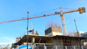 Crane working in construction on blue sky stock video footage