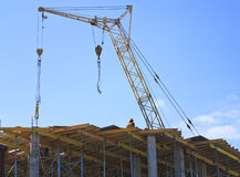 Crane working on the construction of the building Stock Photo
