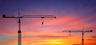 Crane working construction for business industrial and sunset ba Stock Photo