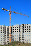 Crane working on construction Royalty Free Stock Image