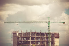 Crane working on construction with retro color tone Royalty Free Stock Photo