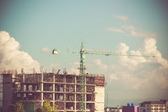 Crane working on construction with retro color tone Royalty Free Stock Images