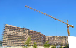 Crane working in construction site. And blue sky Royalty Free Stock Image