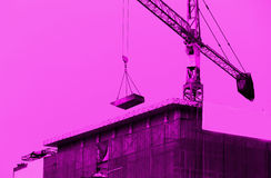 Crane working in construction site Royalty Free Stock Images