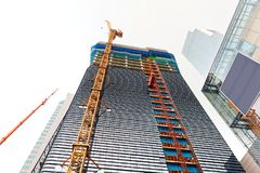 Crane working at a construction site of a new skyscraper - Seoul, South Korea Stock Image