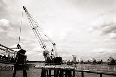Crane working infornt of Thames Barrier on the River Thames, Gre Royalty Free Stock Photo