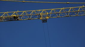 Crane working. Trolley moving on the crane arm stock footage