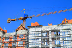 A crane working on the upper floors Royalty Free Stock Photos