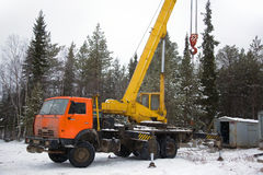 Crane working in the woods in winter Stock Images
