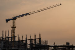 Crane and workplace in the evening Stock Photography