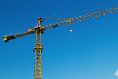 Crane works at a building area Stock Photography