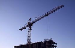 Crane works on building construction area Stock Photos