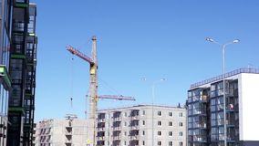 Crane works in city stock video footage