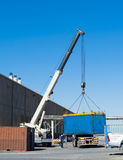 Crane works. Container loading on the truck Stock Image