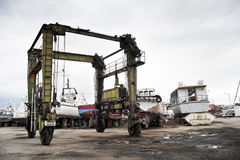 Crane for yacht maintenance. In a boat yard Royalty Free Stock Image