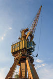 Yellow crane. Old crane already deteriorated on the dock of the port of Rio de Janeiro Royalty Free Stock Image