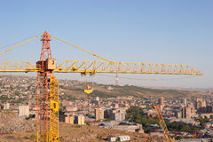 Crane on Yerevan city background. Yerevan downtown view from hill Stock Image