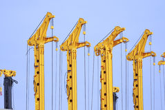 Cranes. Row of yellow drilling rigs Royalty Free Stock Photo