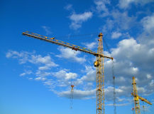 Cranes. Tall Crane on a Building site against a blue sky Stock Photo