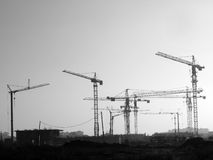 Cranes. Black and white detail of construction site with few cranes Stock Images