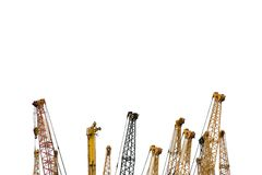 Cranes. The top of many construction cranes Royalty Free Stock Photography