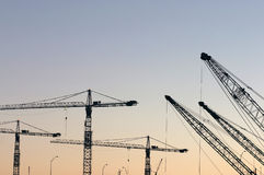 Cranes. Crane booms against the sky royalty free stock photo