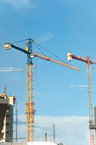 Cranes in action during the construction of a building Royalty Free Stock Photos
