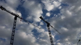 Cranes against a background of blue sky stock footage