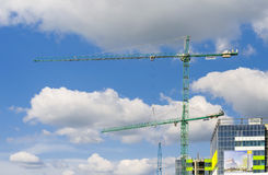 Cranes against blue sky with clouds Stock Photography