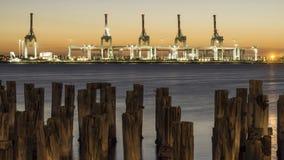 Cranes against a sun setting sky Stock Photo