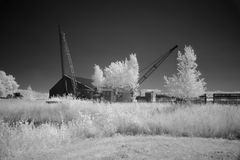 Cranes with barn photographed in infrared light Royalty Free Stock Photos
