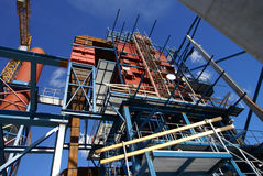 Cranes and beams on construction of industrial plant Royalty Free Stock Image