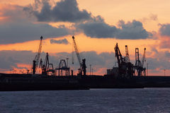 Cranes in Bilbao harbour at sunset Stock Photography