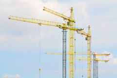 Cranes on blue sky background Royalty Free Stock Photos