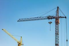 Cranes. Blue sky. Stock Photos